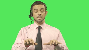 Male talking on headset and typing