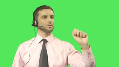 Male talking on headset and pointing