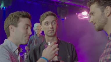 Friends having drink and talking in nightclub