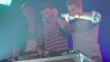 Friends having fun while listening music in nightclub