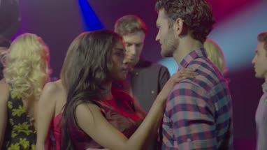 Friends talking and having fun while dancing in nightclub