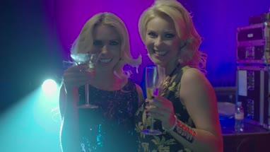 Female friends having fun with champagne in nightclub
