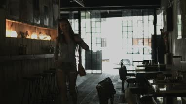 Young woman entering in coffee bar