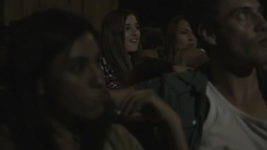 Friends sitting in theatre building and enjoying cinema