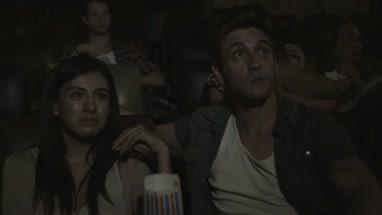 Friends sitting in Movie Theatre and enjoying cinema