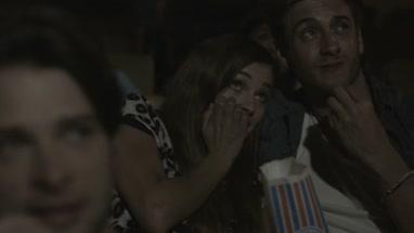 Scared friends watching cinema in Movie Theatre