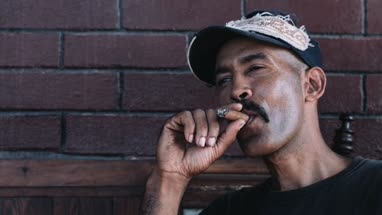 Mature man smoking cigar, close-up