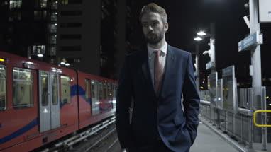 Male business man walking on train platform