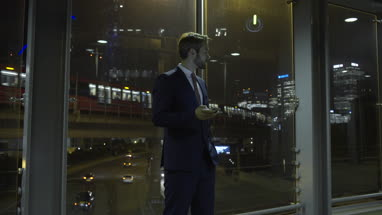 business male looking at smart phone at night