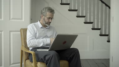 Mature Adult Male working from home on laptop