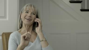 Senior Adult Female at home calling on smart phone