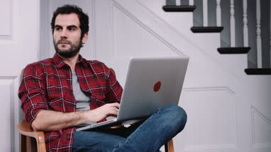 Adult male working on laptop at home