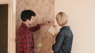 Adult Couple picking colours for home interior