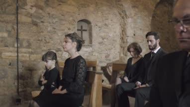 Senior Woman crying at a funeral