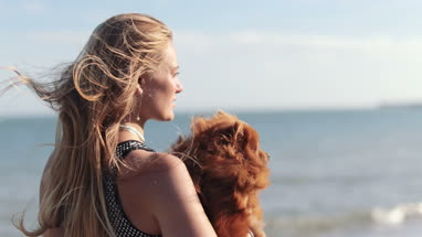 Young female on beach with pet dog