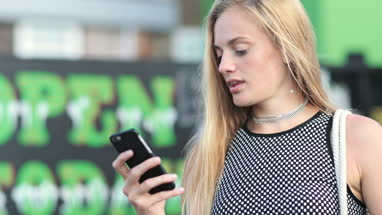 Young female using smartphone