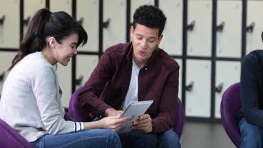 Students sharing digital tablet