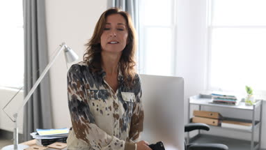 Portrait of mature business woman in office