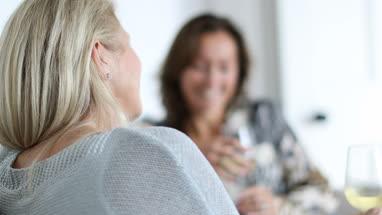 Mature female friends having a conversation