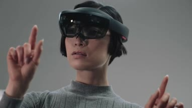 Asian female Using Virtual Reality in creative office