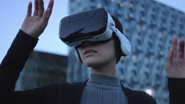 Asian female Using Virtual Reality outside