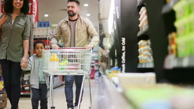 Family doing weekly shop in grocery store