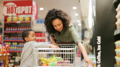 Mother and son doing weekly shop in grocery store