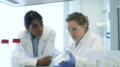Close-up of two female scientists discussing results of experiment