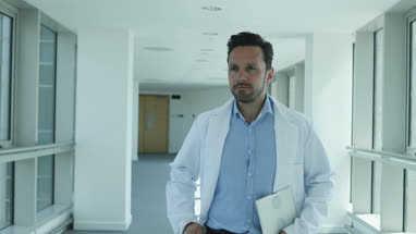 Medical professional checking smartphone on way to meeting