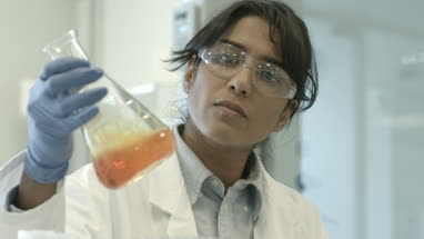 Female scientist analyzing experiment