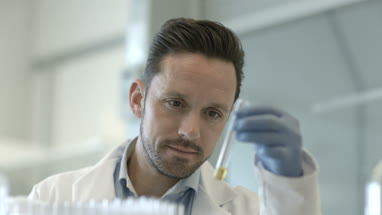 Male scientist looking at test tube in a laboratory