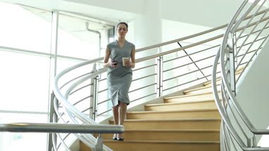 Businesswoman using smartphone app on her way to work