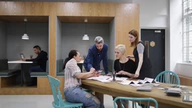 Group of designers choosing samples in a meeting