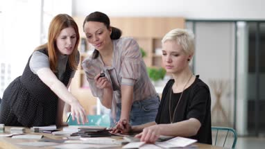 Female designers agreeing on samples in a meeting