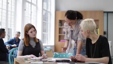 Female designer leading a project planning meeting