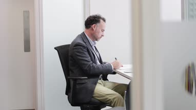 Male Medical Doctor working in his office