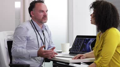 Male Medical Doctor explaining xray results to patient