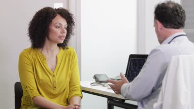 Patient listening to Medical Doctor explain treatment