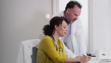 Medical Doctors discussing patient treatment together