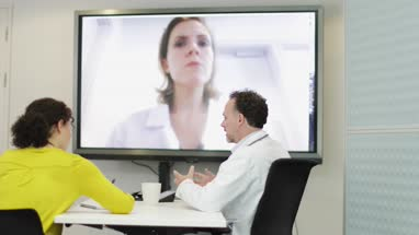 Medical Doctors on a video conference call with specialist