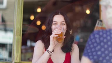 Female friends drinking beer in summer outdoors