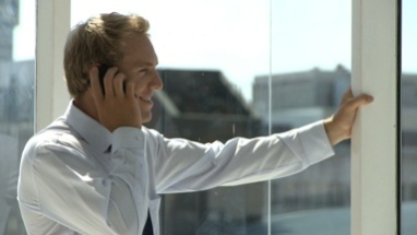 MCU OF A BUSINESSMAN USING A CELL PHONE