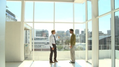 LS WS PAN OF A BUSINESSMAN TALKING TO A CLIENT