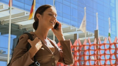MS OF A BUSINESSWOMAN ANSWERING HER CELL PHONE