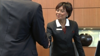 MS OF A BUSINESSWOMAN GREETING A CLIENT