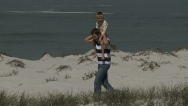 LS OF A FATHER CARRYING HIS SON ON HIS SHOULDERS