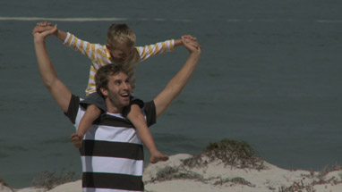 MS OF A FATHER CARRYING HIS SON ON HIS SHOULDERS