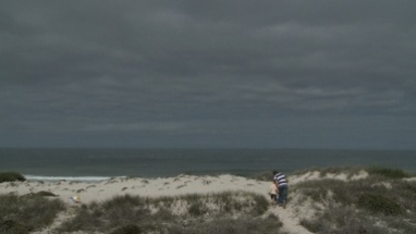 WS PAN OF A FATHER AND SON WALKING UP A PATH TO A BEACH