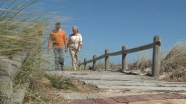 LS OF A SENIOR COUPLE WALKING ALONG A PATH