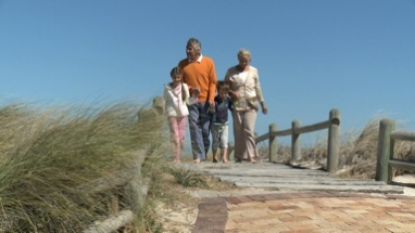 LS OF GRANDPARENTS AND THEIR GRANDCHILDREN WALKING ALONG A PATH